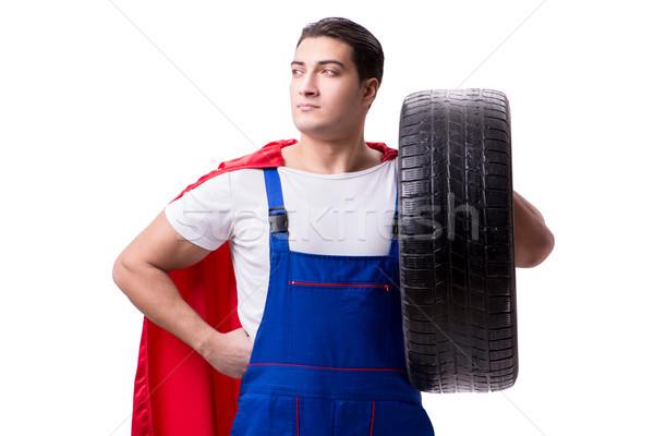 Superhero man with tyre isolated white background Stock photo © Elnur