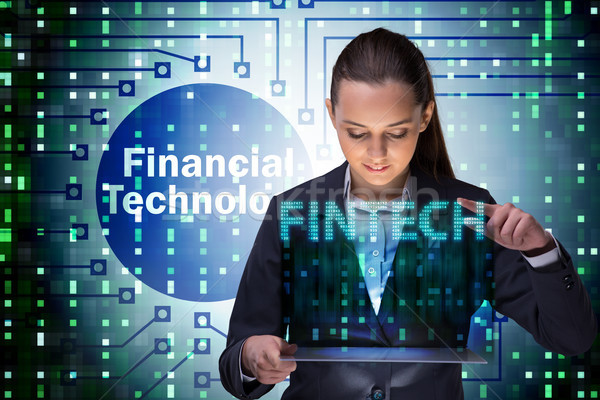 Businesswoman with tablet in financial technology fintech concep Stock photo © Elnur