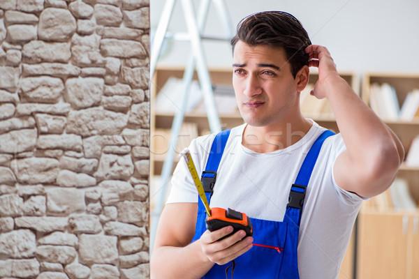 Repairman working with measurement tape Stock photo © Elnur