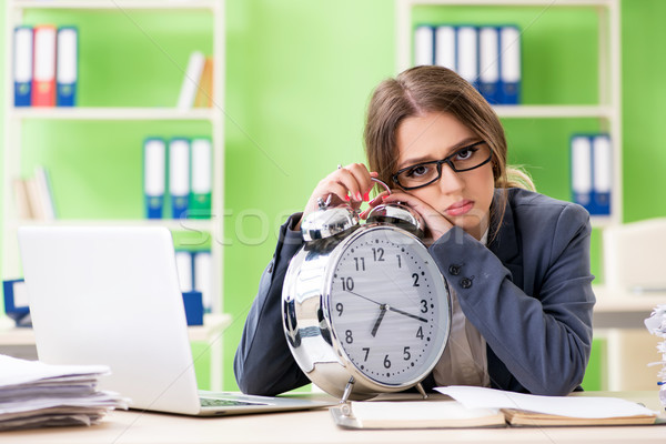 Young female employee very busy with ongoing paperwork in time m Stock photo © Elnur