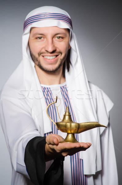 Arab with lamp in studio Stock photo © Elnur