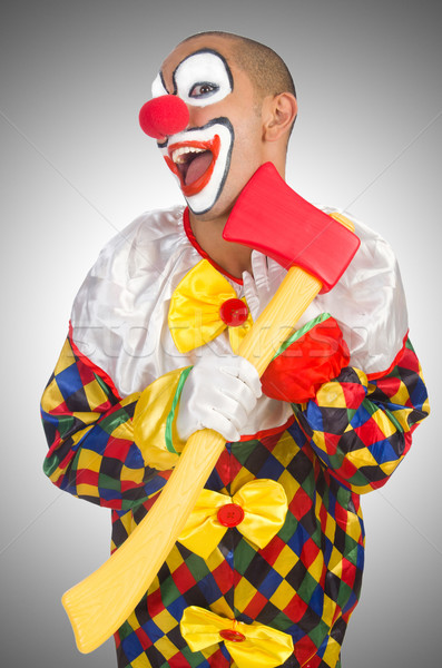 Clown with axe isolated on white Stock photo © Elnur