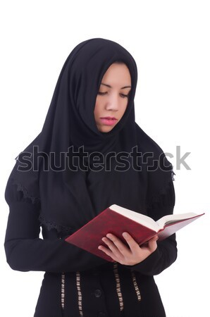 Young nun with bible isolated on white Stock photo © Elnur
