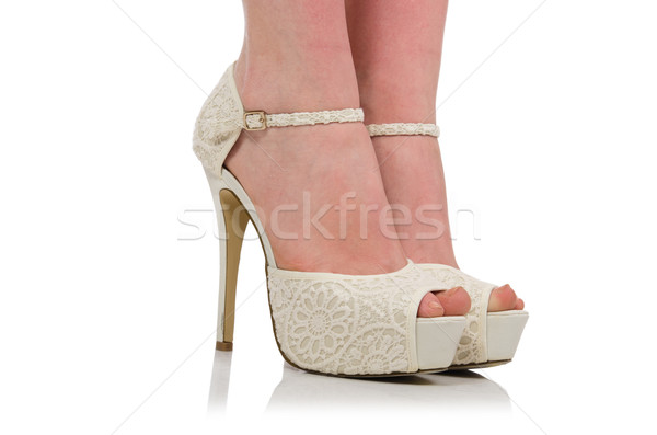 Woman legs with shoes isolated on white Stock photo © Elnur