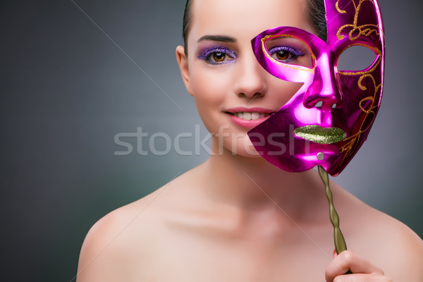Young woman with carnival mask Stock photo © Elnur
