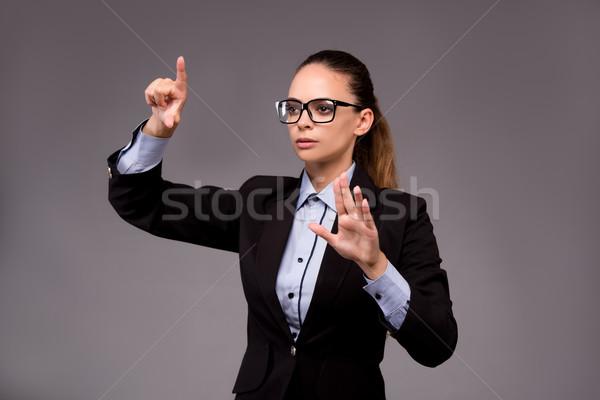 Fiatal nő üzletasszony kisajtolás virtuális gombok üzlet Stock fotó © Elnur