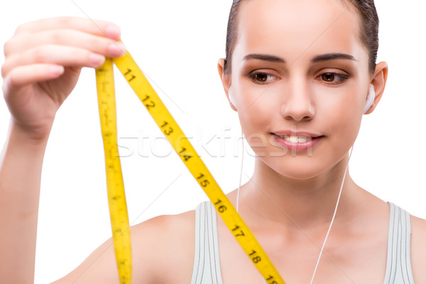 Young woman with centimeter in diet concept Stock photo © Elnur