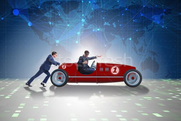 The businessman car pushing in teamwork concept Stock photo © Elnur