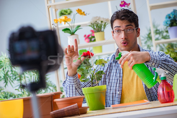 Man florist gardener vlogger blogger shooting video on camera Stock photo © Elnur