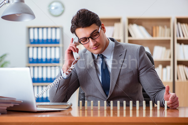 Businessman with dominoes in the office Stock photo © Elnur