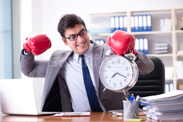 Angry businessman with boxing gloves in time management concept Stock photo © Elnur