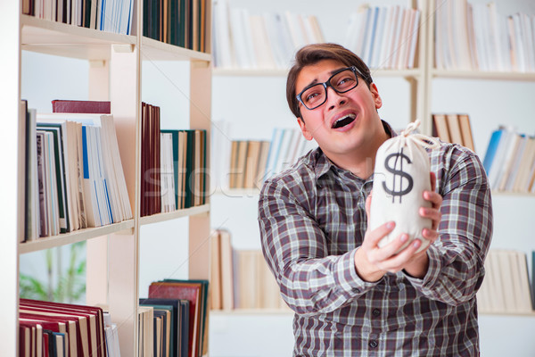 The young student in expensive textbooks concept Stock photo © Elnur