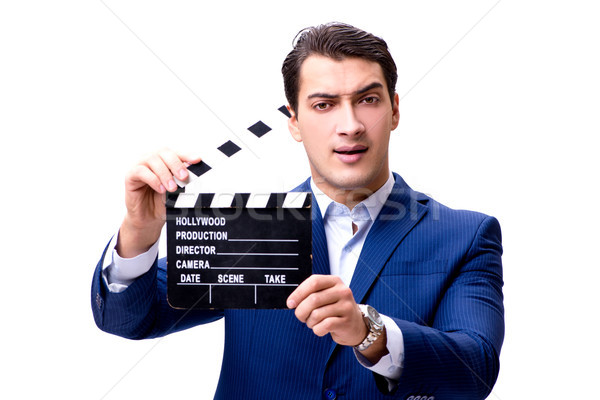 Handsome man with movie clapper isolated on white Stock photo © Elnur