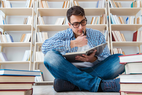 Young student studying with books Stock photo © Elnur