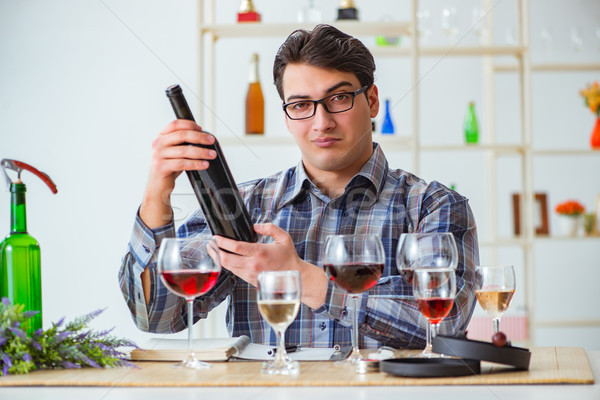 The professional sommelier tasting red wine  Stock photo © Elnur