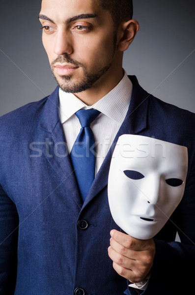 Man with black mask in studio Stock photo © Elnur