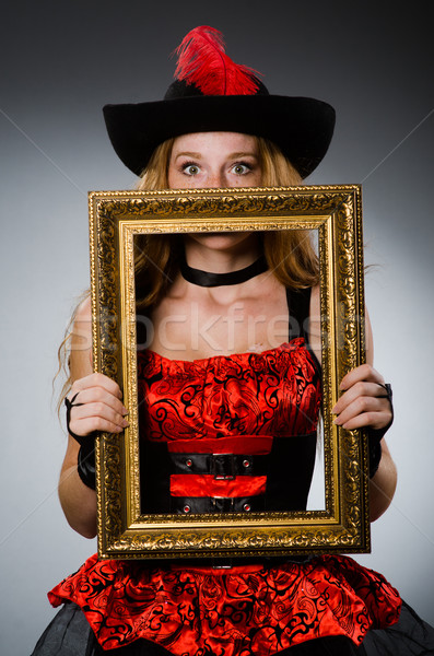 Woman pirate with picture frame Stock photo © Elnur