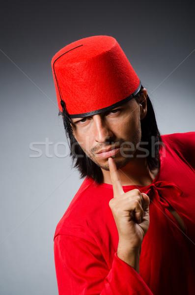 Man in red dress wearing fez hat Stock photo © Elnur