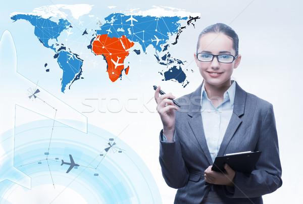 The businesswoman in world transportation concept Stock photo © Elnur