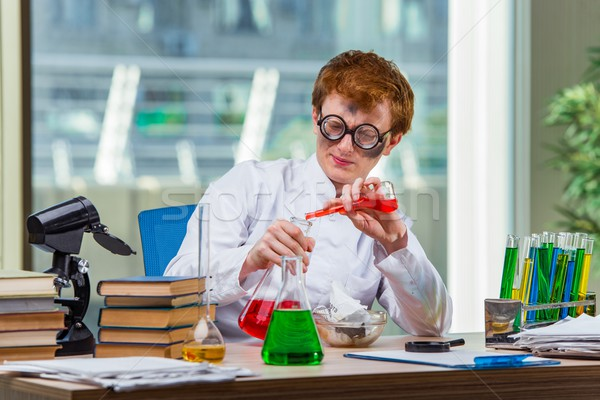 The young crazy chemist working in the lab Stock photo © Elnur