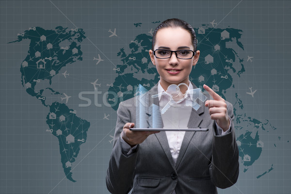 Businesswoman with tablet in hotel booking concept Stock photo © Elnur