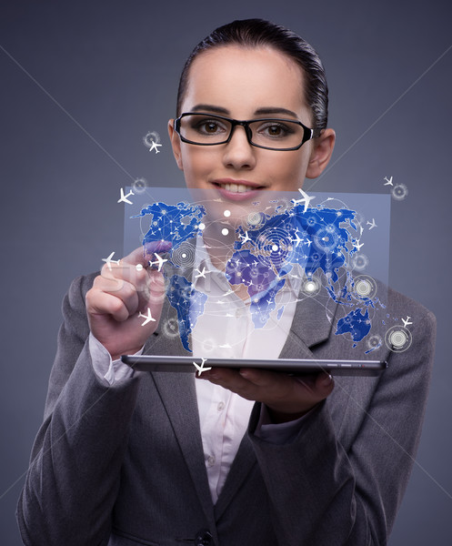 Young businesswoman in online travel booking concept Stock photo © Elnur