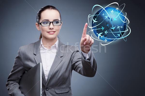 деловая женщина Воздушные путешествия компьютер женщину Мир веб Сток-фото © Elnur