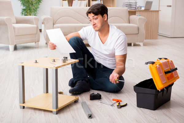 Man assembling shelf at home Stock photo © Elnur