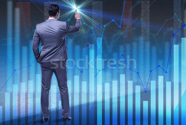 Businessman trader pressing virtual buttons Stock photo © Elnur