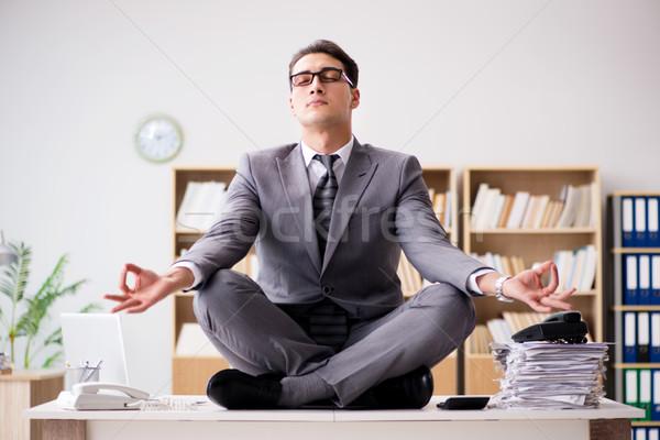 Fiatal üzletember meditál iroda számítógép egészség Stock fotó © Elnur