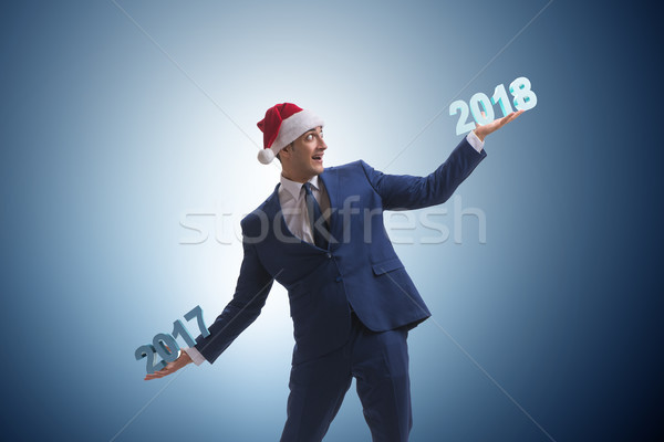 Businessman in santa hat holding 2017 and 2018 Stock photo © Elnur