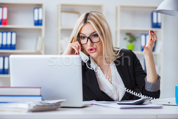Busineswoman frustrated working in the office Stock photo © Elnur