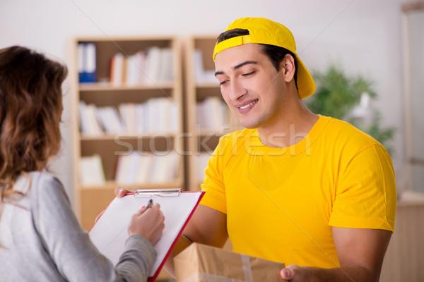 Delivery man delivering parcel box Stock photo © Elnur