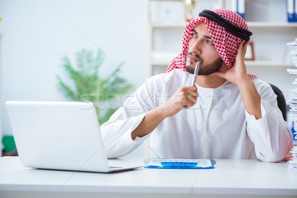 Arab businessman working in the office doing paperwork with a pi Stock photo © Elnur