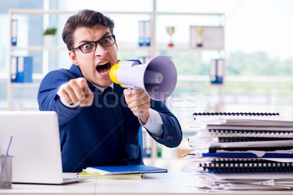 Angry aggressive businessman with bullhorn loudspeaker in office Stock photo © Elnur