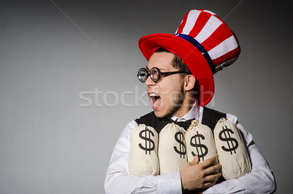 Funny man with american hat and sacks of money Stock photo © Elnur