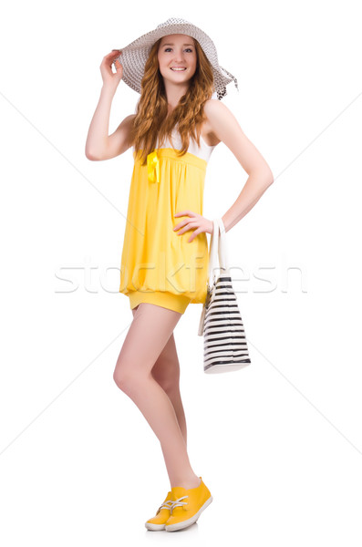 Young woman in yellow summer dress isolated on white Stock photo © Elnur