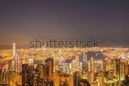 Kilátás Hongkong naplemente égbolt épület város Stock fotó © Elnur