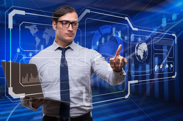 Stock photo: The young businessman in data mining concept