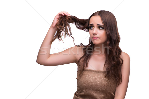 The woman checking her haircut isolated on white Stock photo © Elnur