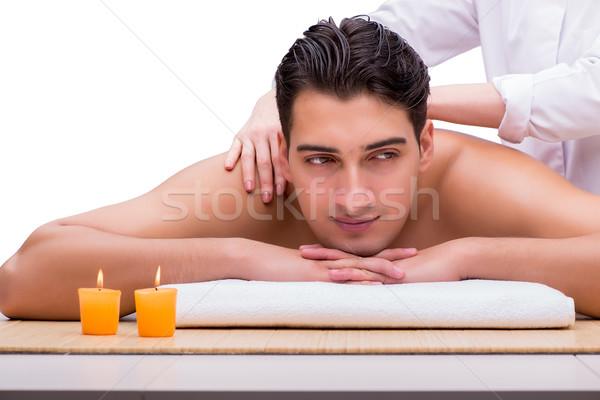 Handsome man during spa massaging session Stock photo © Elnur