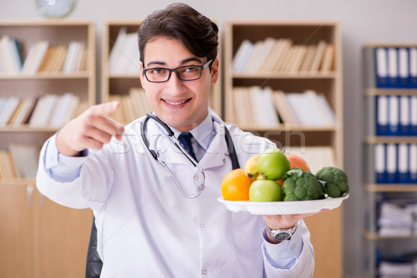 Doctor in dieting concept with fruits and vegetables Stock photo © Elnur