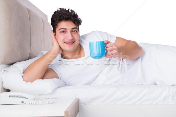 Homme lit souffrance insomnie heureux thé Photo stock © Elnur