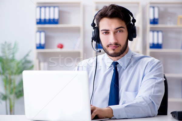 Call center employee working in office Stock photo © Elnur