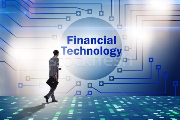Businesswoman walking towards financial technology fintech Stock photo © Elnur