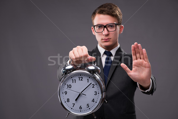 The businessman in time management concept Stock photo © Elnur