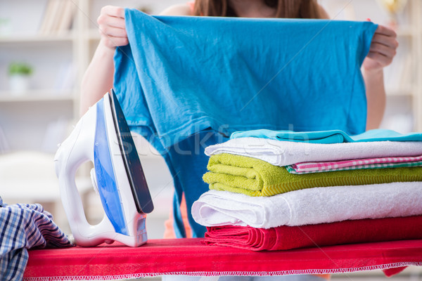 The woman wife doing ironing at home Stock photo © Elnur