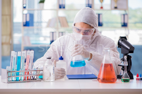 Chemist working in the laboratory with hazardous chemicals Stock photo © Elnur