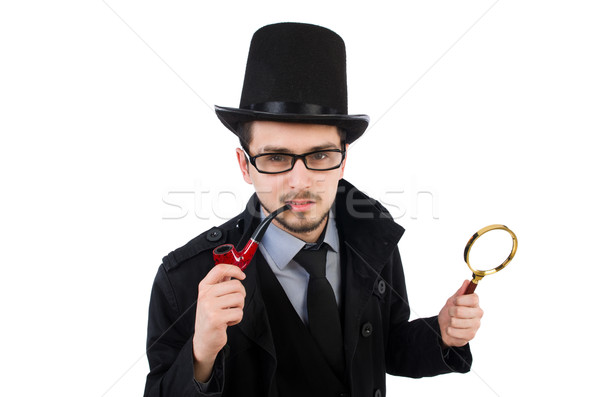 Young detective with magnifying glass isolated on white Stock photo © Elnur