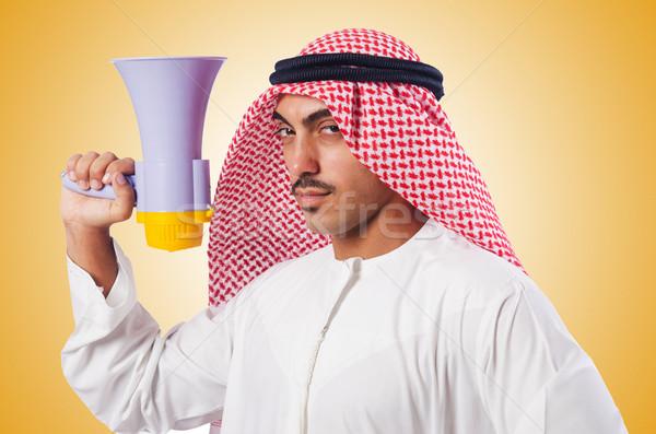 Arab man shouting through loudspeaker Stock photo © Elnur